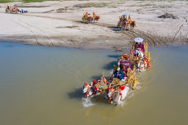 a carriage driving through the water